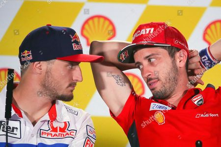 Australian rider Jack Miller (L) of Pramac Racing and Italian MotoGP rider Andrea Dovizioso (R) of Ducati Team attend a press conference ahead of the Motorcycling Grand Prix of Malaysia 2019 at the Sepang International Circuit, outside Kuala Lumpur, Malaysia, 31 October 2019. The 2019 Malaysia Motorcycling Grand Prix will take place on 03 November.