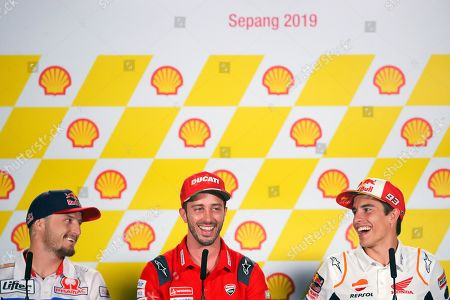 Australian rider Jack Miller (L) of Pramac Racing, Italian MotoGP rider Andrea Dovizioso (C) of Ducati Team and Spanish MotoGP rider Marc Marquez (R) of Repsol Honda Team attend a press conference ahead of the Motorcycling Grand Prix of Malaysia 2019 at the Sepang International Circuit, outside Kuala Lumpur, Malaysia, 31 October 2019. The 2019 Malaysia Motorcycling Grand Prix will take place on 03 November.