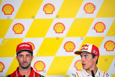 Italian MotoGP rider Andrea Dovizioso (L) of Ducati Team and Spanish MotoGP rider Marc Marquez (R) of Repsol Honda Team attend a press conference ahead of the Motorcycling Grand Prix of Malaysia 2019 at the Sepang International Circuit, outside Kuala Lumpur, Malaysia, 31 October 2019. The 2019 Malaysia Motorcycling Grand Prix will take place on 03 November.