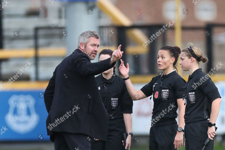Stock Photo of Everton Women manager Willie Kirk speaks with referee Rebecca Walsh at the end of the match