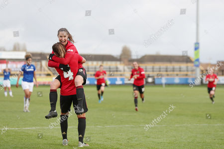 Amy Turner of Manchester United Women FC celebrates scoring her sides third goal with Jane Ross