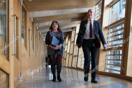 Scottish Parliament First Minister's Questions - Jeane Freeman, Cabinet Secretary for Health and Sport, and John Swinney, Deputy First Minister and Cabinet Secretary for Education and Skills, make their way to the Debating Chamber.