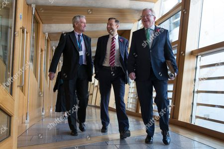 Scottish Parliament First Minister's Questions - Peter Chapman, Liam Kerr and Jackson Carlaw, Interim Leader of the Scottish Conservative and Unionist Party, make their way to the Debating Chamber.