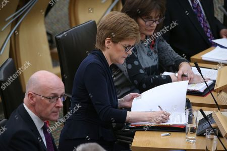 Stock Picture of Scottish Parliament First Minister's Questions - John Swinney, Deputy First Minister and Cabinet Secretary for Education and Skills, Nicola Sturgeon, First Minister of Scotland and Leader of the Scottish National Party (SNP), and Jeane Freeman, Cabinet Secretary for Health and Sport.