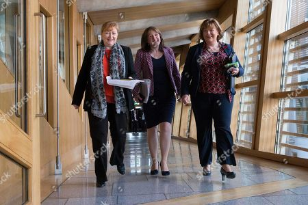 Scottish Parliament First Minister's Questions - Emma Harper, Maree Todd, Minister for Children and Young People, and Fiona Hyslop, Cabinet Secretary for Culture, Tourism and External Affairs, make their way to the Debating Chamber.