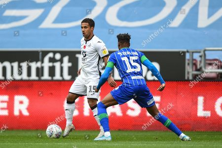 2nd November 2019, DW Stadium, Wigan, England; Sky Bet Championship, Wigan Athletic v Swansea City : Wayne Routledge (15) of Swansea City under pressure from Dujon Sterling (15) of Wigan Athletic  Credit: Richard Long/News Images