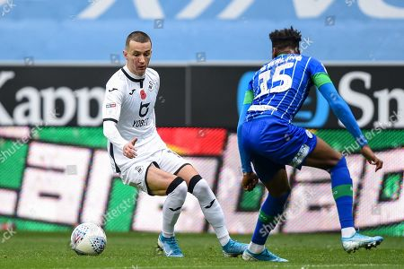 2nd November 2019, DW Stadium, Wigan, England; Sky Bet Championship, Wigan Athletic v Swansea City : Bersant Celina (10) of Swansea City under pressure from Dujon Sterling (15) of Wigan Athletic 