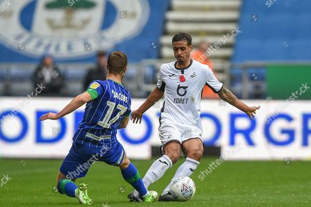 2nd November 2019, DW Stadium, Wigan, England; Sky Bet Championship, Wigan Athletic v Swansea City : Kyle Naughton (26) of Swansea City gets past Michael Jacobs (17) of Wigan Athletic  Credit: Richard Long/News Images