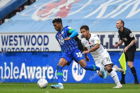 Stock Picture of 2nd November 2019, DW Stadium, Wigan, England; Sky Bet Championship, Wigan Athletic v Swansea City : Dujon Sterling (15) of Wigan Athletic is chased down by Wayne Routledge (15) of Swansea City 
