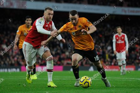 Calum Chambers of Arsenal and Diogo Jota of Wolverhampton Wanderers in action during the Premier League match between Arsenal and Wolverhampton Wanderers at the Emirates Stadium in London, UK - 2nd November 2019