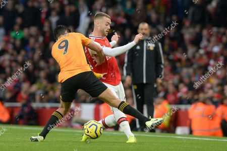 Calum Chambers of Arsenal and Raul Jimenez of Wolverhampton Wanderers in action during the Premier League match between Arsenal and Wolverhampton Wanderers at the Emirates Stadium in London, UK - 2nd November 2019
