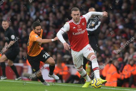 Calum Chambers of Arsenal and Joao Moutinho of Wolverhampton Wanderers in action during the Premier League match between Arsenal and Wolverhampton Wanderers at the Emirates Stadium in London, UK - 2nd November 2019