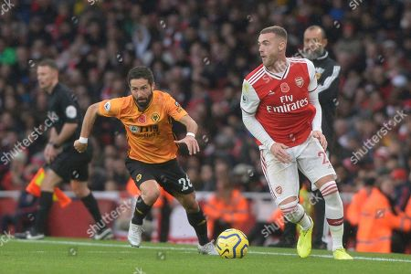 Calum Chambers of Arsenal and Joao Moutinho of Wolverhampton Wanderers in action