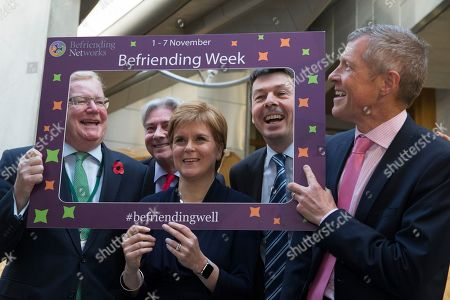 Stock Photo of Befriending Week photocall at The Scottish Parliament - Jackson Carlaw, Interim Leader of the Scottish Conservative and Unionist Party, Richard Leonard, Leader of the Scottish Labour Party, Nicola Sturgeon, First Minister of Scotland and Leader of the Scottish National Party (SNP), Ken Macintosh, The Presiding Officer of The Scottish Parliament, and Willie Rennie, Leader of the Scottish Liberal Democrats.