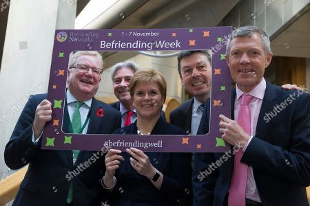 Stock Image of Befriending Week photocall at The Scottish Parliament - Jackson Carlaw, Interim Leader of the Scottish Conservative and Unionist Party, Richard Leonard, Leader of the Scottish Labour Party, Nicola Sturgeon, First Minister of Scotland and Leader of the Scottish National Party (SNP), Ken Macintosh, The Presiding Officer of The Scottish Parliament, and Willie Rennie, Leader of the Scottish Liberal Democrats.