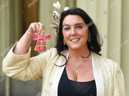 Historian and TV presenter Bettany Hughes with her OBE presented to her at Buckingham Palace.