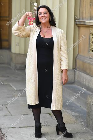Stock Image of Historian and TV presenter Bettany Hughes with her OBE presented to her at Buckingham Palace.