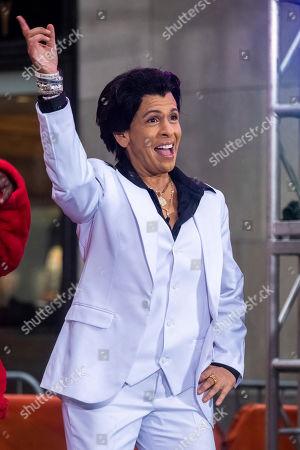 "Hoda Kotb dresses as John Travolta's character from ""Saturday Night Fever"" during the ""Today"" show Halloween celebration at Rockefeller Plaza, in New York"