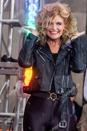 """Savannah Guthrie dresses as Olivia Newton-John's character from """"Grease"""" during the """"Today"""" show Halloween celebration at Rockefeller Plaza, in New York"""