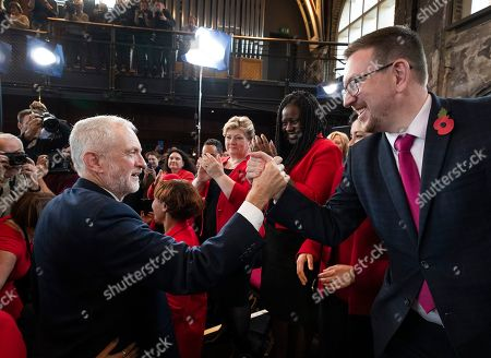 Labour Party Leader Jeremy Corbyn greets shadow cabinet member Andrew Gwynne as Battersea MP Marsha de Cordova (2R) and Shadow Foreign Secretary Emily Thornberry look on after speaking to supporters at Battersea Arts Centre during an election campaign rally.