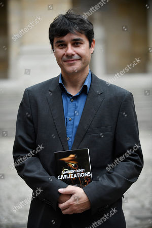 French writer Laurent Binet, the laureate of the French Academy Novel Grand Prize 2019 for his novel 'Civilizations', poses for the photographers with a copy of his book at the French Academy in Paris, France, 31 October 2019.