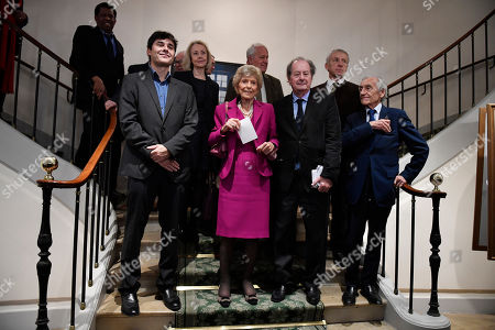 The Permanent Secretary Helene Carrere d'Encausse (C) and members to The Academie Francaise pose with French writer Laurent Binet (L), the laureate of the French Academy Novel Grand Prize 2019 for his novel 'Civilizations', at the French Academy in Paris, France, 31 October 2019.
