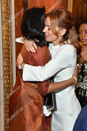 Dhulsini De Zoysa and Author Geri Horner hug during a reception for winners of the Queen's Commonwealth essay competition 2019 at Buckingham Palace