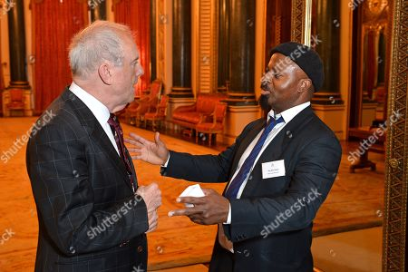 Compere for the event Gyles Brandreth and Poet Ben Okri during a reception for winners of the Queen's Commonwealth essay competition 2019 at Buckingham Palace