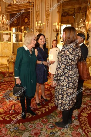 Camilla Duchess of Cornwall meets with Author Evie Wyld and Poet Ben Okri during a reception for winners of the Queen's Commonwealth essay competition 2019 at Buckingham Palace