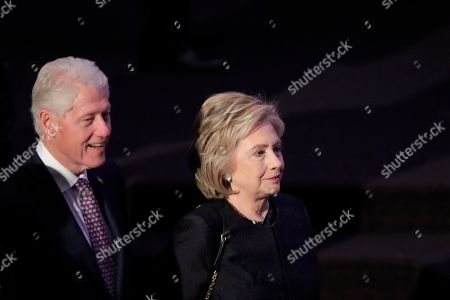 Former President Bill Clinton, left, walks with his wife, former Secretary of State Hillary Rodham Clinton, while arriving for funeral services for the late U.S. Rep. Elijah Cummings, in Baltimore. The Maryland congressman and civil rights champion died Thursday, Oct. 17, at age 68 of complications from long-standing health issues