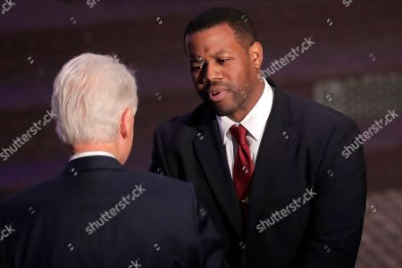 Harry Spikes, right, congressional staff member for the late U.S. Rep. Elijah Cummings, talks to former President Bill Clinton after speaking during funeral services for Cummings, in Baltimore. The Maryland congressman and civil rights champion died Thursday, Oct. 17, at age 68 of complications from long-standing health issues