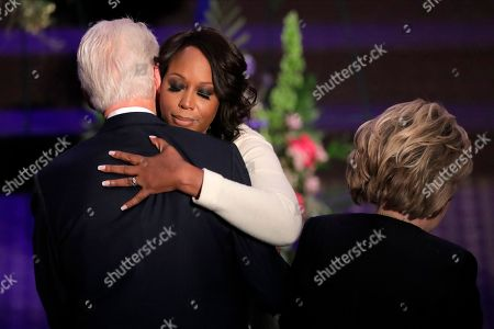 Stock Image of Maya Rockeymoore Cummings, center, hugs former President Bill Clinton as his wife former Secretary of State Hillary Rodham Clinton looks on after speaking during funeral services for the late U.S. Rep. Elijah Cummings, in Baltimore. The Maryland congressman and civil rights champion died Thursday, Oct. 17, at age 68 of complications from long-standing health issues