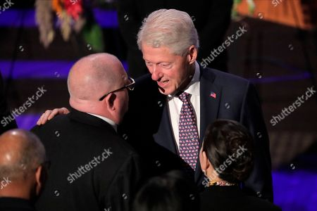 Former President Bill Clinton, right, talks to Maryland Gov. Larry Hogan during funeral services for the late U.S. Rep. Elijah Cummings, in Baltimore. The Maryland congressman and civil rights champion died Thursday, Oct. 17, at age 68 of complications from long-standing health issues