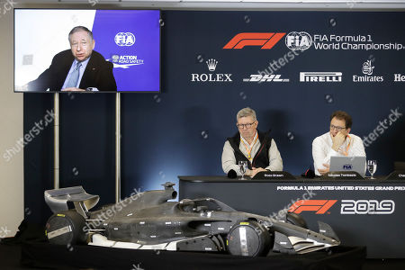 Ross Brawn, left, and Nikolas Tombazis listen as FIA president Jean Todt speaks by video link during a news conference at the Formula One U.S. Grand Prix auto race at the Circuit of the Americas, in Austin, Texas