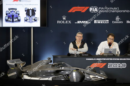 Ross Brawn, left, and Nikolas Tombazis speak during a news conference at the Formula One U.S. Grand Prix auto race at the Circuit of the Americas, in Austin, Texas