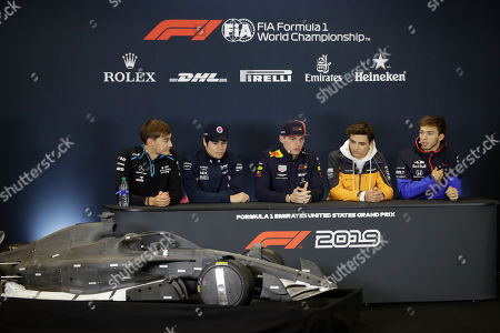 Red Bull driver Max Verstappen, center, of the Netherlands, speaks during a news conference at the Formula One U.S. Grand Prix auto race at the Circuit of the Americas, in Austin, Texas. Williams driver George Russell, of Britain, from left, Racing Point driver Lance Stroll, of Canada, McLaren driver Lando Norris, of Britain, and Toro Rosso driver Pierre Gasly, of France, listen as Verstappen speaks about the car changes for 2021
