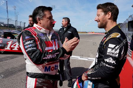 Tony Stewart talks with Haas driver Romain Grosjean, of France, before Grosjean drives a NASCAR Cup Series car owned by Stewart-Haas Racing at the Formula One U.S. Grand Prix auto race at the Circuit of the Americas, in Austin, Texas