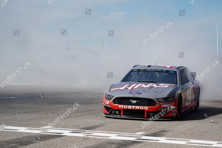 Haas drivers Romain Grosjean, of France, Kevin Magnussen, of Denmark, drive a NASCAR Cup Series car owned by Stewart-Haas Racing at the Formula One U.S. Grand Prix auto race at the Circuit of the Americas, in Austin, Texas