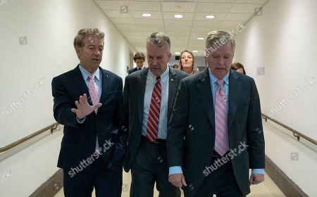 United States Senator Rand Paul (Republican of Kentucky), United States Senator Thom Tillis (Republican of North Carolina), and United States Senator Lindsey Graham (Republican of South Carolina) leave a closed-door briefing on Syria in the U.S. Capitol