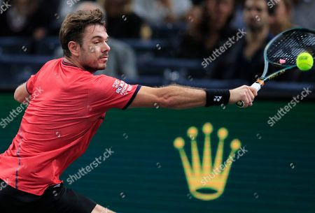 Swiss Stan Wawrinka returns the ball to Spain's Rafael Nadal during the 3rd round match of the Paris Masters tennis tournament in Paris, France