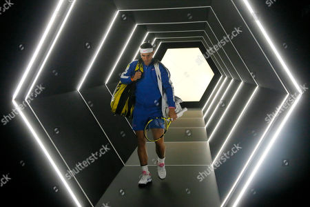 Spain's Rafael Nadal walks through the tunnel as he arrives to play Swiss Stan Wawrinka during the 3rd round match of the Paris Masters tennis tournament in Paris, France