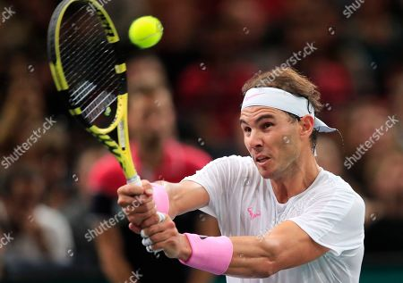 Spain's Rafael Nadal returns the ball to Swiss Stan Wawrinka during the 3rd round match of the Paris Masters tennis tournament in Paris, France