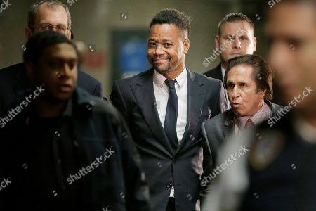 Cuba Gooding Jr. arrives to court with his attorney Mark J. Heller, right, in New York, . Gooding Jr. has pleaded not guilty to an indictment that includes allegations from a new accuser in his New York City sexual misconduct case. Prosecutors at Thursday's arraignment said they've also heard from several more women who could testify that the 51-year-old actor has had a habit of groping women over the years. Gooding's criminal case now includes allegations from three women
