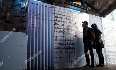 People look the temporary art installation 'The Writing on the Wall', a traveling installation made up of essays, poems, letters, drawings and notes by people in prison around the world, in the Highline park in New York, New York, USA, 31 October 2019. The installation, which is in place from 31 October until 10 November 2019, is a collaboration between artist Hank Willis Thomas and Dr. Baz Dreisinger,  the founder of the Prison-to-College Pipeline program at John Jay College of Criminal Justice.