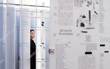 A person looks at the temporary art installation 'The Writing on the Wall', a traveling installation made up of essays, poems, letters, drawings and notes by people in prison around the world, in the Highline park in New York, New York, USA, 31 October 2019. The installation, which is in place from 31 October until 10 November 2019, is a collaboration between artist Hank Willis Thomas and Dr. Baz Dreisinger,  the founder of the Prison-to-College Pipeline program at John Jay College of Criminal Justice.