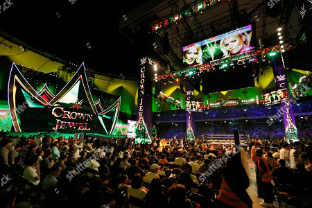 """Saudi wrestling fans wait to watch World Wrestling Entertainment """"WWE"""" stars Lacey Evans and Natalya Neidhart, on top screen, as they play the first-ever women's wrestling match in Saudi at King Fahd International Stadium in Riyadh, Saudi Arabia"""
