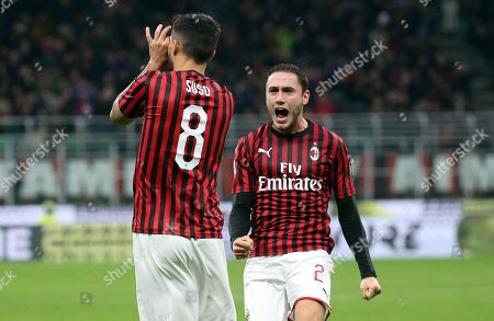 Stock Photo of Milan's Suso (front) jubilaltes with his teammate Davide Calabria after scoring the goal during the Italian Serie A soccer match AC Milan vs S.P.A.L. at the Giuseppe Meazza stadium in Milan, Italy, 31 October 2019.