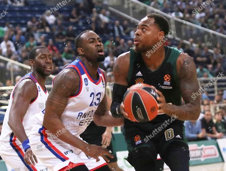 Thomas Deshaun of Panathinaikos (R) in action against James Anderson of Anadolou Efes (C) during the round 6 Euroleague basketball match Panathinaikos vs Anadolu Efes at the Olympic Indoor Stadium in Athens, Greece, 31 October 2019.