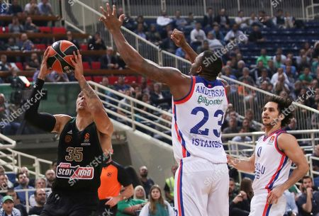 Jacob Wiley of Panathinaikos (L) in action against James Anderson of Anadolou Efes (C) during the round 6 Euroleague basketball match Panathinaikos vs Anadolu Efes at the Olympic Indoor Stadium in Athens, Greece, 31 October 2019.