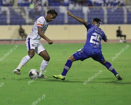 Al-Hilal player Andre Carrillo (L) in action against Al-Fateh player Tawfiq Buhumaid (R) during the Saudi Professional League soccer match between Al-Fateh and Al-Hilal at Prince Abdullah bin Jalawi Stadium, Al-Hasa, Saudi Arabia, 31 October 2019.
